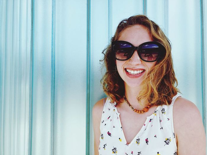 Happy woman with sunglasses. Glasses Sunglasses One Person Fashion Portrait Headshot Young Adult Adult Emotion Hairstyle Leisure Activity Lifestyles Real People Young Women Smiling Front View Happiness Outdoors Women Beautiful Woman