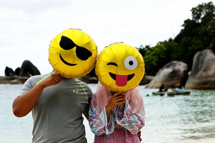 Adult Adults Only Anthropomorphic Face Anthropomorphic Smiley Face Bonding Couple Vacation Day Emoticons Happy Couple Happy Vacation  Mouth Open Outdoors People Smiling Togetherness Two People Vacation Vacation On The Beach Water Young Adult Young Women