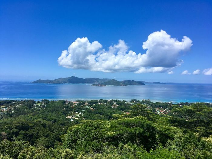 Seychelles Panorama View Beauty In Nature Blue Seychelles Travel Destinations Sky Water Beauty In Nature Cloud - Sky Sea Plant Scenics - Nature Day Nature Horizon Over Water Horizon Idyllic Land Outdoors