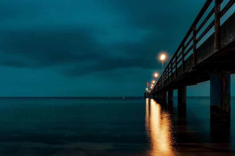 Lanterns on pier at night
