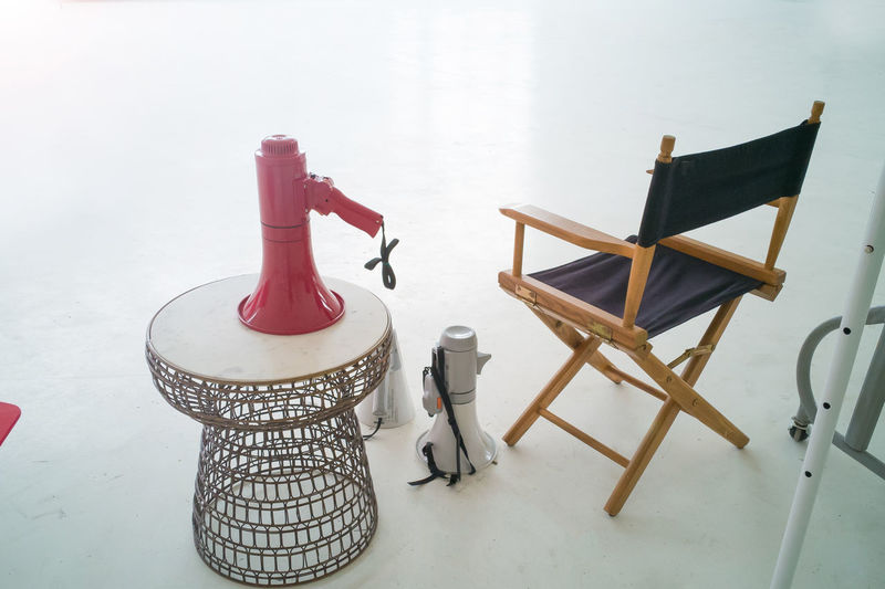 High angle view of chairs on table against wall at home