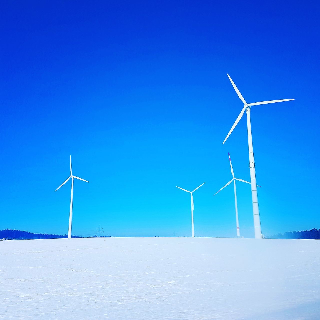 wind turbine, wind power, alternative energy, environmental conservation, fuel and power generation, renewable energy, cold temperature, winter, windmill, industrial windmill, snow, blue, outdoors, nature, field, day, no people, landscape, tranquility, beauty in nature, scenics, technology, sky