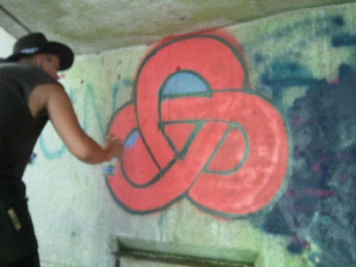Street Photography Art Creativity Making A Statement  Under The Bridge Daytime Unrecognizable Person Man In Hat Symbol