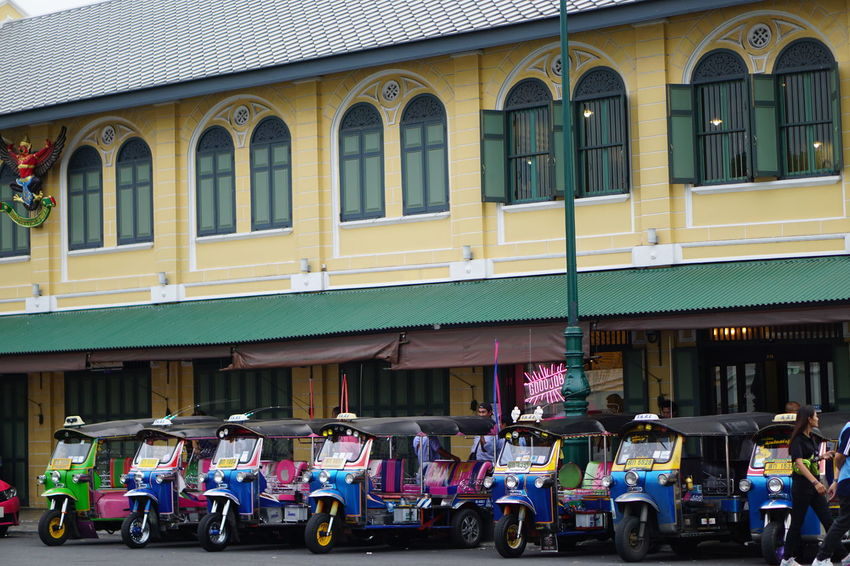 Outdoors Building Exterior Architecture Day City Travel Destinations Vacations Community People Adult Tuk Tuk In Bangkok Colorful Multi Colored Transportation