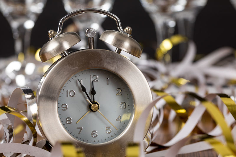 Close-Up Of Alarm Clock On Ribbons