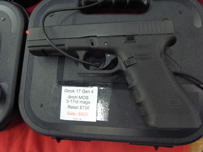 Glock 17 9mm for sale at gun show in Louisiana 9mm American Arms GLOCK Gun Knarre Louisiana USA Car Close-up Communication Control Dangerous Day Engine Gun And Knife Show Gun Show Guns High Angle View Indoors  Land Vehicle Law Machinery Mode Of Transportation Motor Vehicle No People Number Pistole Technology Text Transportation Vehicle Interior Weapon Weapon Exhibition Weapon Law Western Script