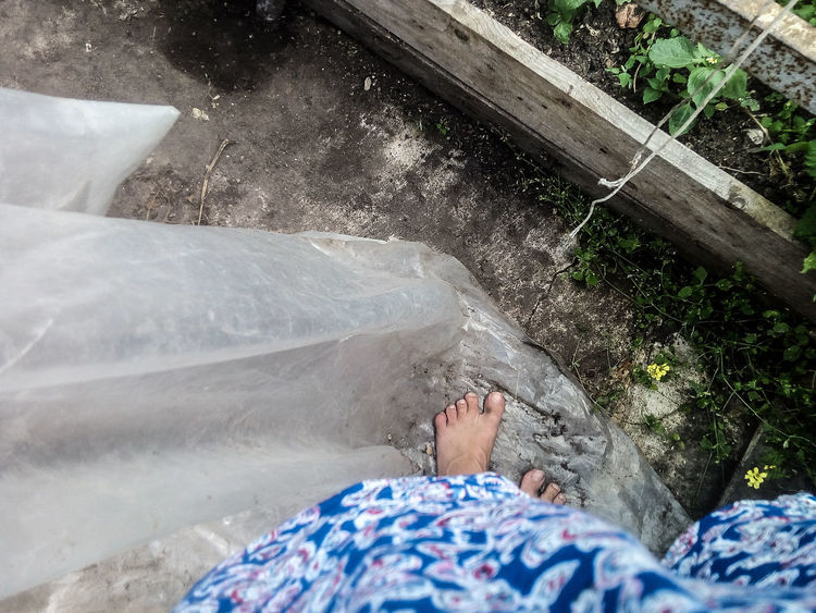 One Person Adults Only Relaxation High Angle View People Day Adult Leisure Activity Outdoors Young Adult Human Body Part Real People Nature Freshness Greenhouse Feet Abstract Abstract Photography Abstract Minimalism  Human Leg Barefoot Lifestyles Water Low Section