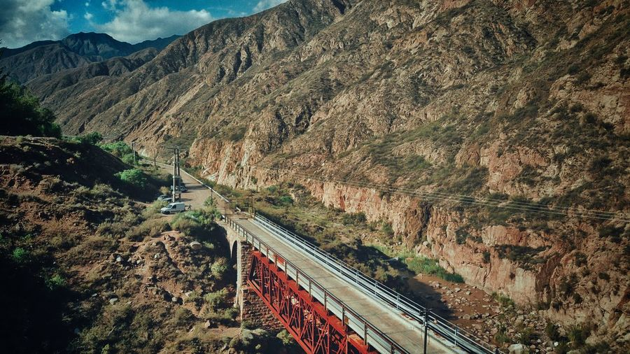 Aerial view of bridge by mountain range