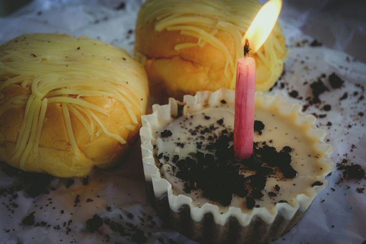 """Don't regret another birthday, the good news is that you are alive and can celebrate it.""-Catherine Pulsifer Celebrate Bread Candle Cake Cup Cake Cheese Bread Lit Candle Sprinkles Food Food And Drink Light A New Beginning EyeEmNewHere"