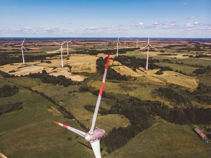Wind power Drone  Dronephotography Drone Photography Droneshot Aerial Aerial View Grass Above Above The Ground Look Lithuanian Lithuanianboy Green Color Green Aerial Shot Lithuania Lietuva Wind Windpowerplant Windpower Wind Power Wind Power Generator EyeEm Selects Sea Beach Water Sky Barbed Wire Summer In The City