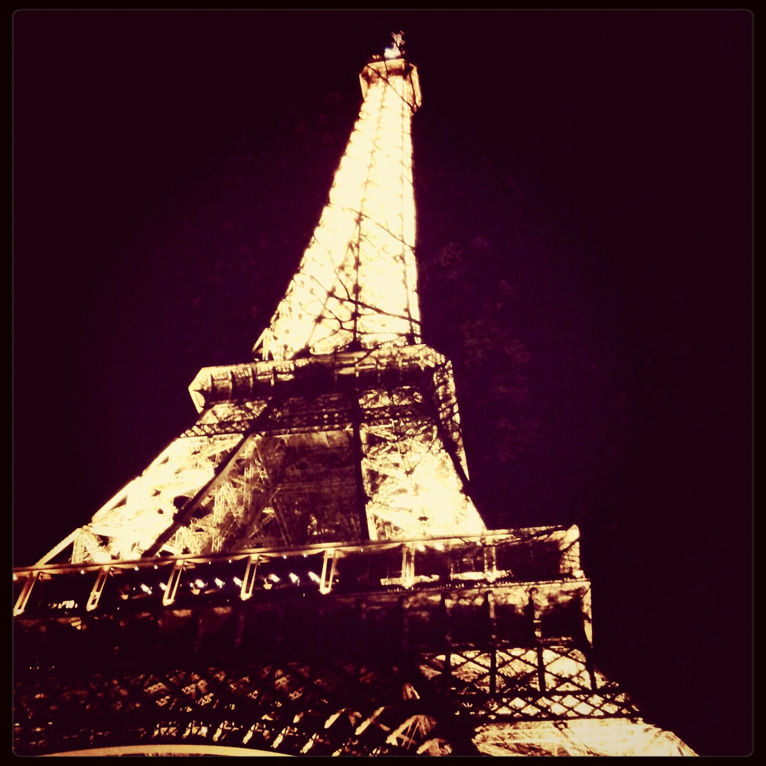 built structure, architecture, low angle view, building exterior, clear sky, tower, transfer print, auto post production filter, tall - high, metal, eiffel tower, international landmark, famous place, travel destinations, sky, outdoors, development, copy space, history, no people