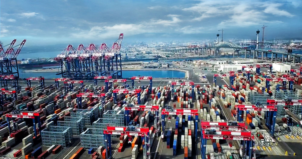 High angle view of commercial dock against sky in city