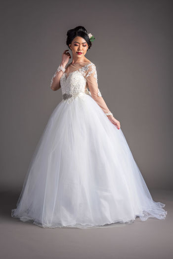 Anne May modelling for Karentino Bridal Bridal Photoshoot Elegant Adult Beautiful Woman Bridal Gowns Bride Clothing Event Fashion Full Length Indoors  Model Pose Newlywed One Person Portrait Studio Shot Wedding Wedding Dress Young Adult