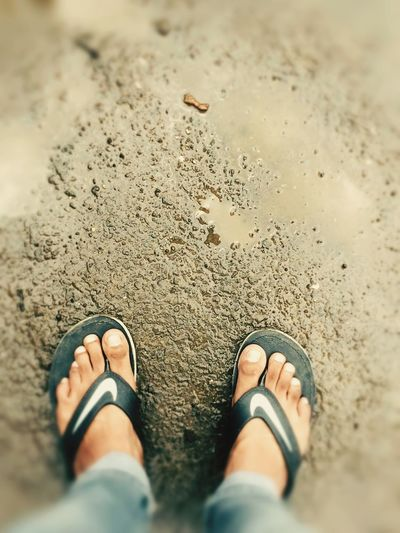 EyeEm Selects Beach Real People Low Section Human Leg Sand Standing Shoe One Person Personal Perspective High Angle View Shore Day Men Outdoors Wet Human Body Part Lifestyles Water Nature Close-up