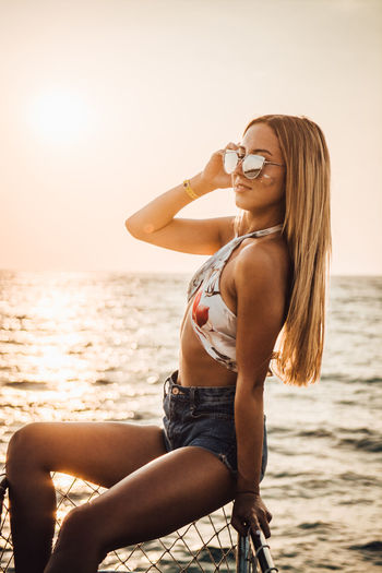 One Person Young Adult Sea Water Beach Young Women Lifestyles Leisure Activity Three Quarter Length Real People Bikini Clothing Sky Land Glasses Swimwear Nature Fashion Beautiful Woman Hairstyle Hair Outdoors