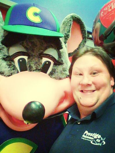 Me and Chuck E. Cheese hanging out.