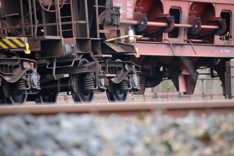 Surface level of steam train on railroad tracks