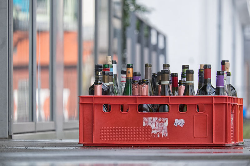 Close-up of empty bottles in red box