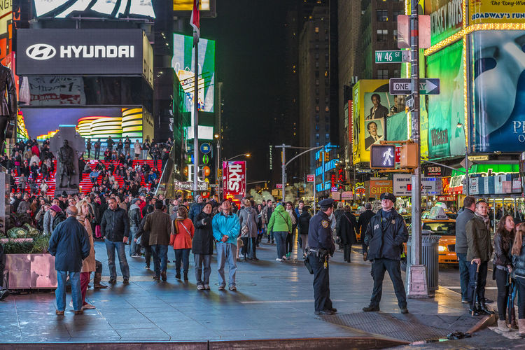Time Square, Manhattan at night time. City Group Of People Crowd Large Group Of People Street Real People Architecture Building Exterior City Life Walking Men Built Structure City Street Text Communication Road Transportation Adult Women Outdoors Police Officers Times Square NYC Night Life