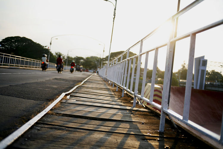 People on bridge against clear sky