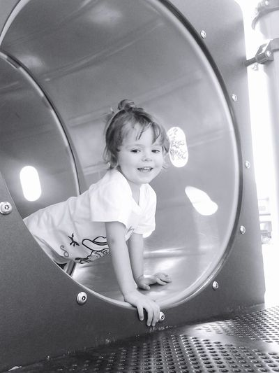 Cute Girl Looking Away In Tunnel At Park