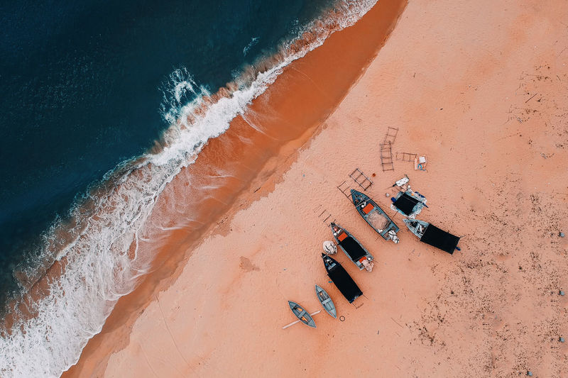 Aquatic Sport Beach Beauty In Nature Day High Angle View Land Motion Nature Non-urban Scene Outdoors Sand Scenics - Nature Sea Sport Sunlight Surfing Water Wave