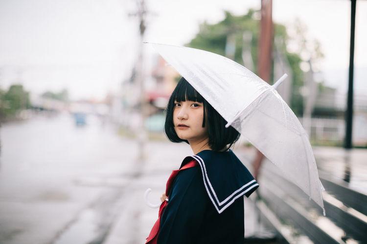 Portrait of woman standing in rain