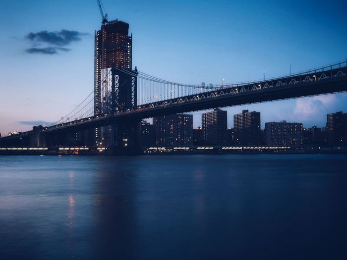 New York 2017 Skyline New York City Manhattan Bridge America Travel Photography Sunset By The River Wanderlust Olympus VSCO NYC Photography EyeEm Selects City Cityscape Urban Skyline Water Illuminated Skyscraper Steel Clear Sky Horizon Industry