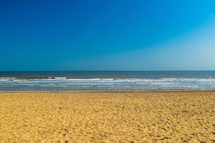 Sea Beach Sky Scenics - Nature Horizon Over Water Land Water Horizon Beauty In Nature Tranquility Tranquil Scene Sand Blue Copy Space Nature Clear Sky Idyllic Day No People Outdoors Beach Photography Space For Text Space For Copy