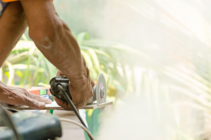 Close-up of man working outdoors