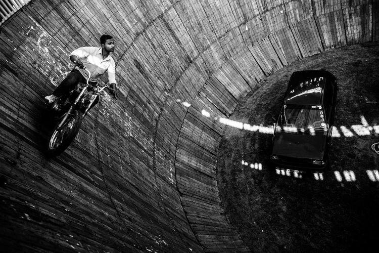 High angle view of man riding motorcycle