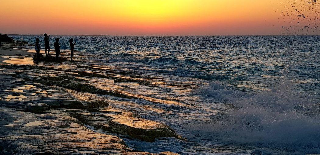 North coast, Alexandria, Egypt Water Wave Sea Sunset Beach Horizon Power In Nature Sand Sunlight Silhouette