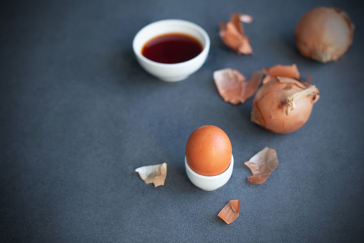 Instructions how to color easter eggs with natural dye. orange color from onion skin. copy space.