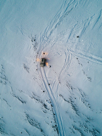 Drone still of Icelandic winter landscape Car Cold Temperature Day High Angle View Mammal Nature Outdoors Pets Snow Winter