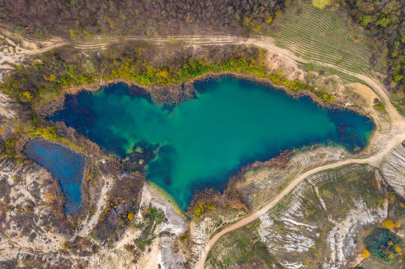Aerial view of lake amidst dramatic land