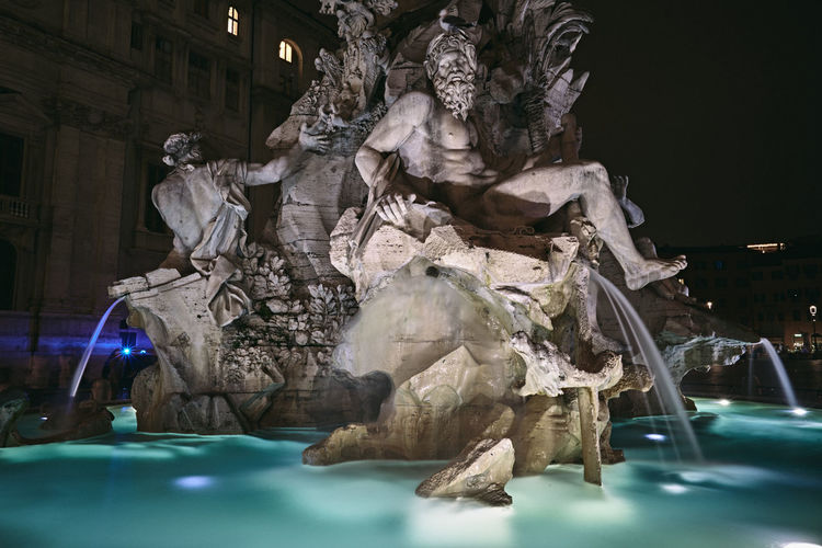 Statue of fountain at night