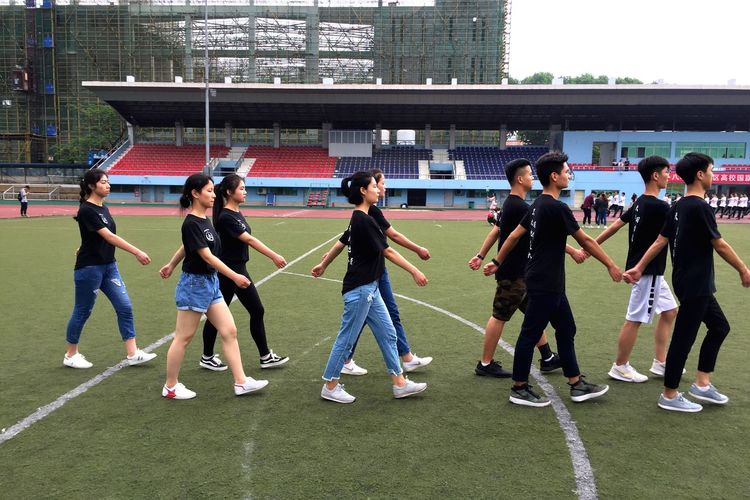 Chinese students marching. Military Marching Band Chinese Students Students Marching Men And Women Group Of People Sport People Men Grass Real People Full Length Lifestyles Adult Crowd Women Outdoors Track And Field Standing