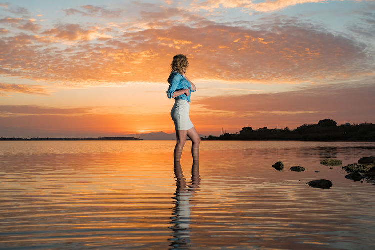 Adult Adults Only Adventure Beauty In Nature Cloud - Sky Day Full Length Human Body Part Human Hand Lake Nature One Person One Young Woman Only Outdoors People Sky Sunset Vacations Young Adult