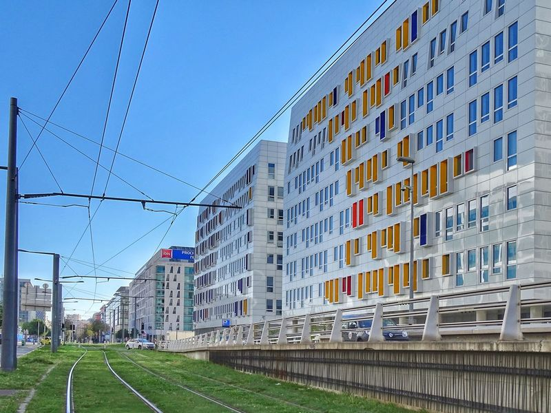 Architecture Building Exterior Built Structure Grass Sky Outdoors City Day No People Cloud - Sky Streetphoto_color EyeEm Multi Colored Colors Business Finance And Industry Architecture Eyeem Color Photos🌈 Eyeem Colors EyeEm Yellow Eyeem Blue Tram Marseille, France