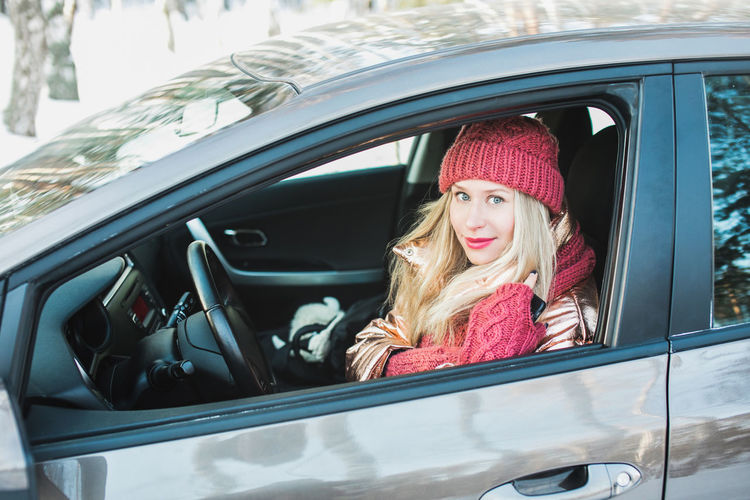 Blonde Driver Red Winter Beautiful Woman Car Caucasian Cheerful Close-up Day Female Happiness Land Vehicle Lifestyles Looking At Camera One Person Outdoors Portrait Real People Smiling Transportation Young Adult Young Women