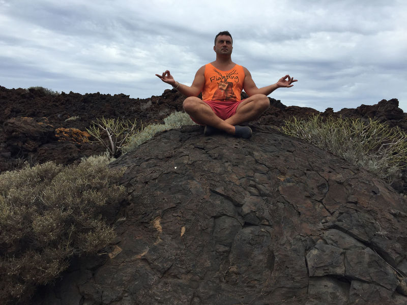 Adult Cloud - Sky Day El Hierro, Canary Islands, Spain Front View Leisure Activity Lotus Position Nature One Person Outdoors Portrait Sitting Sky