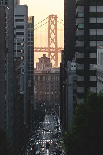 Aerial view of street amidst modern buildings in city