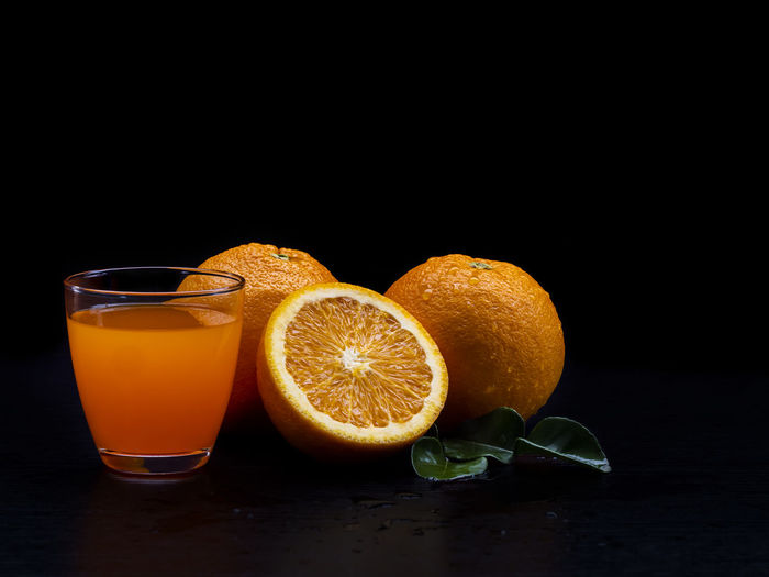 Orange juice against black background