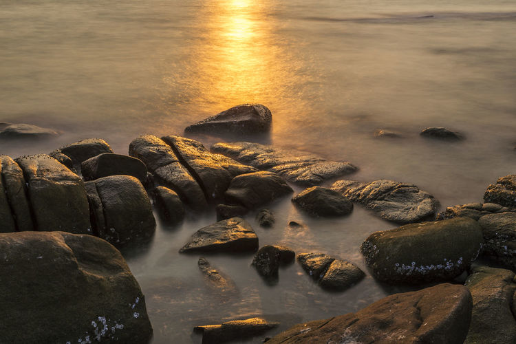 Light of the evening sun over the sea shoot with long exposure speed Light Beauty In Nature Flowing Flowing Water Idyllic Long Exposure Motion Nature No People Outdoors Pebble Rock Rock - Object Scenics - Nature Sea Shallow Slow Shutter Slowspeed Solid Stone Sunset Water Wet