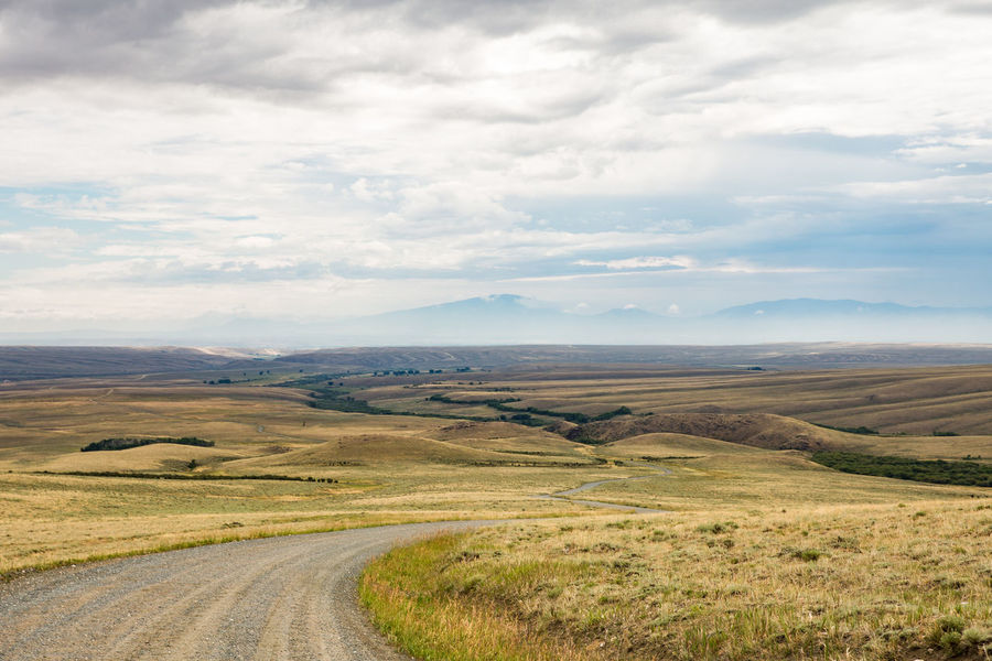 Wyoming roads Landscape_Collection Road Rolling Landscape United States Wild West Wyoming Wyoming USA Wyoming Landscape America Cloud - Sky Environment Grass Land Landscape Mountain Nature Non-urban Scene Outdoors Public Land Road Rolling Landscape Scenics - Nature Tranquility