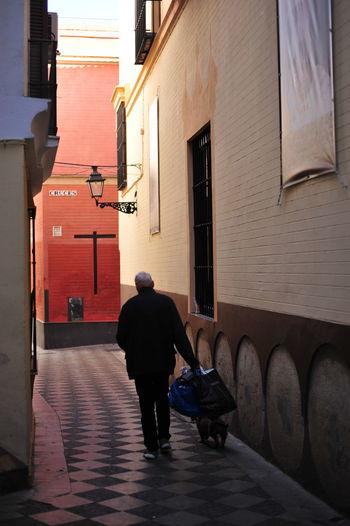 Full length rear view of man walking in city