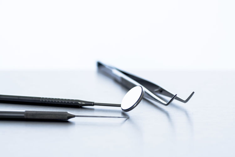 Close-up Day Dentist Dentist Tools Indoors  No People Probe Studio Shot Tweezers White Background