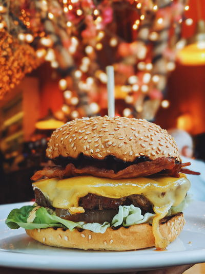 Bread Bun Burger Business CheeseBurger Close-up Fast Food Focus On Foreground Food Food And Drink Freshness Hamburger Indoors  Indulgence Meat No People Plate Ready-to-eat Sandwich Snack Still Life Table Temptation Tray Unhealthy Eating