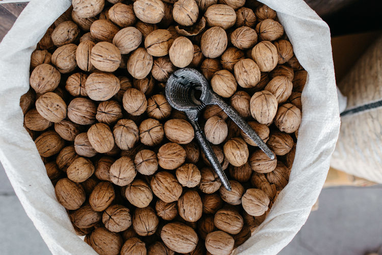 Directly above shot of walnuts in sack