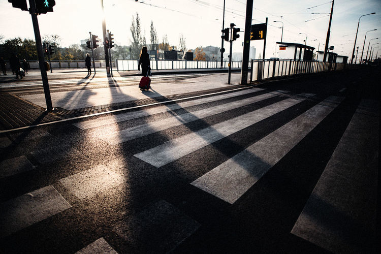 Autumn The Week on EyeEm Architecture City Crossing Crosswalk Day Fog Light And Shadow Long Shadow - Shadow Marking Men Nature Nostalgia Outdoors People Real People Road Road Marking Shadow Sign Street Streetphotography Sunlight Symbol The Past The Way Forward Transportation Walking Zebra Crossing Streetwise Photography